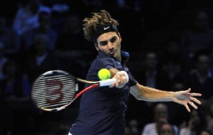 Federer of Switzerland retruns the ball during his singles tennis match against Nadal of Spain at the ATP World Tour Finals in London